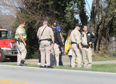 """<div class=""""source"""">RANDY PATRICK/The Kentucky Standard</div><div class=""""image-desc"""">Sheriff's deputies talked with witnesses who helped a woman who was badly burned by an outbuilding fire Saturday afternoon on Louisville Road.</div><div class=""""buy-pic""""><a href=""""/photo_select/93506"""">Buy this photo</a></div>"""