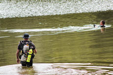 "<div class=""source"">KACIE GOODE/The Kentucky Standard</div><div class=""image-desc"">A diver with Louisville Metro Underwater Search and Rescue wades toward another in Melody Lake Wednesday afternoon. The diving team also visited in July, shortly after the disappearance of 35-year-old Crystal Rogers, but the police presence has not been confirmed to be releted to any investigation.</div><div class=""buy-pic""><a href=""/photo_select/69271"">Buy this photo</a></div>"