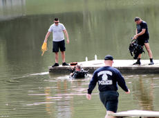 "<div class=""source"">KACIE GOODE/The Kentucky Standard</div><div class=""image-desc"">Divers with Louisville Metro Underwater Search and Rescue were at Melody Lake again Wednesday. The diving team also visited in July, shortly after the disappearance of 35-year-old Crystal Rogers, but the police presence has not been confirmed to be releted to any investigation.</div><div class=""buy-pic""><a href=""/photo_select/69272"">Buy this photo</a></div>"