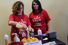 """<div class=""""source"""">KACIE GOODE/The Kentucky Standard</div><div class=""""image-desc"""">Katelyn Brown prepares """"The Outlaw"""" for Old Talbott Tavern during the Mixed Drink Challenge as team member Heather Richards looks on.</div><div class=""""buy-pic""""><a href=""""/photo_select/59823"""">Buy this photo</a></div>"""