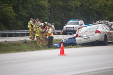 "<div class=""source"">TREY CRUMBIE/The Kentucky Standard</div><div class=""image-desc"">A fatal accident occurred Thursday evening between the 14 and 15-mile markers on Bluegrass Parkway. This is the third car-related fatality this week. Eastbound traffic toward Bardstown was delayed as first responders worked the scene. Crews were on scene for more than an hour. </div><div class=""buy-pic""><a href=""/photo_select/68343"">Buy this photo</a></div>"