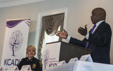 "<div class=""source"">KACIE GOODE/The Kentucky Standard</div><div class=""image-desc"">Louisville Metro Council President David James talks during a Purple Purse Challenge luncheon Friday at My Old Kentucky Home Great Hall. The event was hosted by the Kentucky Coalition Against Domestic Violence. At left, Bardstown Police Chief Kim Kraeszig listens.</div><div class=""buy-pic""><a href=""/photo_select/98823"">Buy this photo</a></div>"