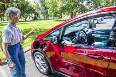 "<div class=""source"">KACIE GOODE/The Kentucky Standard</div><div class=""image-desc"">Sister Molly Thompson stands by her Chevrolet Bolt. Thompson is the first EV driver for Nazareth as the Sisters of Charity look to reduce their carbon footprint by eventually replacing a fleet of conventional vehicles with electric ones.</div><div class=""buy-pic""><a href=""/photo_select/96571"">Buy this photo</a></div>"