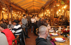 """<div class=""""source"""">RANDY PATRICK/The Kentucky Standard</div><div class=""""image-desc"""">The tent was elegantly decorated, but the dinner attire was casual for the Jim Beam Holiday Feastival Friday night at the Stillhouse.</div><div class=""""buy-pic""""><a href=""""/photo_select/91469"""">Buy this photo</a></div>"""