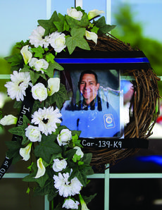 "<div class=""source"">File Photo</div><div class=""image-desc"">A memorial was held Friday morning for Bardstown Police Officer Jason Ellis, who was murdered five years ago on May 25, 2013. This photo was taken during a memorial shortly after his death. </div><div class=""buy-pic""><a href=""/photo_select/95625"">Buy this photo</a></div>"