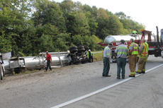 """<div class=""""source"""">RANDY PATRICK/The Kentucky Standard</div><div class=""""image-desc"""">Fire Chief J.T. Bass and Asst. Chief Billy Mattingly talk with employees of Mackin Wrecker Service while employees of Clean Harbor Environmental offload a liquid from the tanker of an overturned tanker on the Bluegrass Parkway. The accident happened about 9:30 p.m. Tuesday</div><div class=""""buy-pic""""><a href=""""/photo_select/69484"""">Buy this photo</a></div>"""
