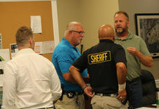 """<div class=""""source"""">RANDY PATRICK/The Kentucky Standard</div><div class=""""image-desc"""">Sheriff Ramon Pineiroa had to separate Magistrate Eric Shelburne, right, and Don Thrasher, left, after an argument during a Fiscal Court meeting Tuesday over Thrasher's proposal that the magistrates start each meeting with the Pledge of Allegiance.</div><div class=""""buy-pic""""></div>"""