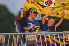 "<div class=""source"">File Photo/The Kentucky Standard</div><div class=""image-desc"">Fairgoers enjoy a ride during the kick off of the Nelson County Fair in 2018. The Nelson County Fair returns Monday.</div><div class=""buy-pic""></div>"