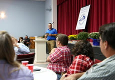 """<div class=""""source"""">KACIE GOODE/The Kentucky Standard</div><div class=""""image-desc"""">Vice President P.J. Milburn speaks to the family of Buck Durbin while presenting the Farmers Hall of Fame recognition at the Nelson County Farm Bureau annual dinner Tuesday.</div><div class=""""buy-pic""""><a href=""""/photo_select/80321"""">Buy this photo</a></div>"""