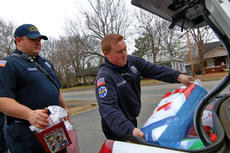 "<div class=""source"">KACIE GOODE/The Kentucky Standard</div><div class=""image-desc"">Firefighters load presents into the trunk of a car Friday morning after helping making Christmas special for a family in need.</div><div class=""buy-pic""><a href=""/photo_select/91827"">Buy this photo</a></div>"