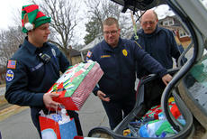 "<div class=""source"">KACIE GOODE/The Kentucky Standard</div><div class=""image-desc"">Firefighters load presents into the trunk of a car Friday morning after helping making Christmas special for a family in need.</div><div class=""buy-pic""><a href=""/photo_select/91826"">Buy this photo</a></div>"