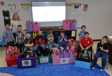 "<div class=""source"">KACIE GOODE/The Kentucky Standard</div><div class=""image-desc"">Amy Brandenburg's class at Foster Heights Elementary donated several gift bags to families of patients at Norton Children's Hospital in Louisville.</div><div class=""buy-pic""><a href=""/photo_select/90410"">Buy this photo</a></div>"