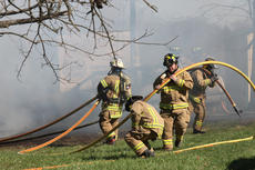 """<div class=""""source"""">RANDY PATRICK/The Kentucky Standard</div><div class=""""image-desc"""">Firefighters pull hose to fight an outbuilding fire that burned a resident Saturday.</div><div class=""""buy-pic""""><a href=""""/photo_select/93507"""">Buy this photo</a></div>"""