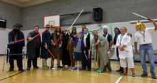 """<div class=""""source"""">KACIE GOODE/The Kentucky Standard</div><div class=""""image-desc"""">Bardstown Middle School staff pose for a photo with sixth-grader Gabriel Schepker, center, after performing a Star Wars-themed skit during Friday's morning assembly. Schepker was surprised as a special character in the skit.</div><div class=""""buy-pic""""><a href=""""/photo_select/85711"""">Buy this photo</a></div>"""
