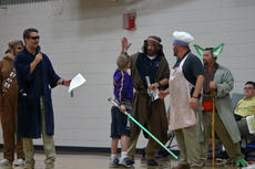 """<div class=""""source"""">KACIE GOODE/The Kentucky Standard</div><div class=""""image-desc"""">Sixth-grader Gabriel Schepker high fives Eric Hardin, AKA ReadingRainbow Kenobi, after a Star Wars-themed skit at Friday's morning assembly at Bardstown Middle. Gabriel has a life-threatening heart condition and is in the process of getting on a list for a transplant.</div><div class=""""buy-pic""""><a href=""""/photo_select/85712"""">Buy this photo</a></div>"""