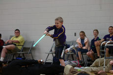 """<div class=""""source"""">KACIE GOODE/The Kentucky Standard</div><div class=""""image-desc"""">Gabriel Schepker is victorious as he defeats the enemy and saves the Hadorn's delivery man. The Bardstown Middle School sixth-grader was surprised with a Star Wars-themed skit Friday morning.</div><div class=""""buy-pic""""><a href=""""/photo_select/85714"""">Buy this photo</a></div>"""