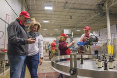 """<div class=""""source"""">KACIE GOODE/The Kentucky Standard</div><div class=""""image-desc"""">Michael """"Bart"""" and Renea Bartoszek introduced a bottling line (ReBart Bottling Company) into the Guthrie Opportunity Center recently to provide participants with new kinds of jobs. Renea's son, Jacob Poston, is a participant of the center which provides work, training, socializing and more for Nelson County residents who may have special needs. The Center collaborates with Communicare and Nelson County Industries, as well as a variety of community partners to provide jobs for participants.</div><div class=""""buy-pic""""><a href=""""/photo_select/83403"""">Buy this photo</a></div>"""