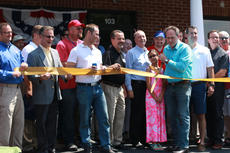 """<div class=""""source"""">SPENCER HARSH/The Kentucky Standard</div><div class=""""image-desc"""">Robert Augustine cuts the ribbon in front Nelson County's new GOP headquarters while surrounded by party supporters and candidates on Saturday afternoon. </div><div class=""""buy-pic""""><a href=""""/photo_select/96758"""">Buy this photo</a></div>"""