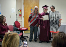 """<div class=""""source"""">KACIE GOODE/The Kentucky Standard</div><div class=""""image-desc"""">Graduate Clayton Sweatt poses for a photo with program director Dianne Bratcher and education specialist Rachel Daugherty Monday night during a ceremony at the Bardstown/Nelson County Adult and Community Education Center.</div><div class=""""buy-pic""""><a href=""""/photo_select/91592"""">Buy this photo</a></div>"""