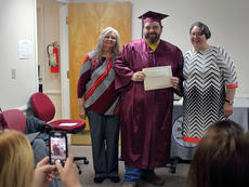 """<div class=""""source"""">KACIE GOODE/The Kentucky Standard</div><div class=""""image-desc"""">Graduate Michael Booker poses for a photo with program director Dianne Bratcher and education specialist Rachel Daugherty Monday night during a ceremony at the Bardstown/Nelson County Adult and Community Education Center.</div><div class=""""buy-pic""""><a href=""""/photo_select/91591"""">Buy this photo</a></div>"""