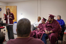 """<div class=""""source"""">KACIE GOODE/The Kentucky Standard</div><div class=""""image-desc"""">Guest speaker Heather Reynolds, of ECTC's Springfield Campus, shares a message Monday night during a special graduation ceremony for the Bardstown/Nelson County Adult and Community Education Center. At right, attending graduates Clayton Sweatt and Michael Booker listen.</div><div class=""""buy-pic""""><a href=""""/photo_select/91590"""">Buy this photo</a></div>"""