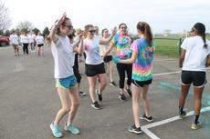 """<div class=""""source"""">RANDY PATRICK/The Kentucky Standard</div><div class=""""image-desc"""">Maddie Ritchie and Emma Mattingly douse walkers with paint at the second stop on the Reagan Carter 5K Color Run Saturday at Dean Watts Park.</div><div class=""""buy-pic""""><a href=""""/photo_select/94525"""">Buy this photo</a></div>"""