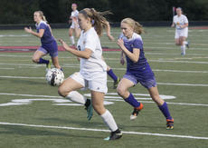 "<div class=""source"">PETER W. ZUBATY/The Kentucky Standard</div><div class=""image-desc"">Bethlehem&#039;s Madie Sparks dribbles the ball upfield while Bardstown&#039;s Lakin Festervan gives chase in the Banshees&#039; 2-1 shootout win in Wednesday&#039;s 19th District girls&#039; soccer championships. The two will be expected to provide senior leadership for their teams after key graduation losses.</div><div class=""buy-pic""></div>"