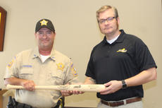 "<div class=""source"">RANDY PATRICK/The Kentucky Standard</div><div class=""image-desc"">Nelson County Deputy Sheriff Jerry Hardin receives a Louisville Slugger baseball bat from Michael Schwendau of the Office of Highway Safety for being a division winner in the Highway Safety All Stars.</div><div class=""buy-pic""><a href=""/photo_select/88705"">Buy this photo</a></div>"