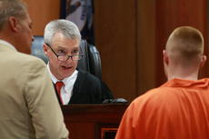 "<div class=""source"">SPENCER HARSH/The Kentucky Standard</div><div class=""image-desc"">Defendant Damion Murphy listens to instructions from Circuit Judge Charles Simms in his plea hearing Tuesday. He pleaded guilty to first-degree robbery and facilitation to murder and was one of four defendants in the case.</div><div class=""buy-pic""></div>"