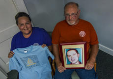 "<div class=""source"">KACIE GOODE/The Kentucky Standard</div><div class=""image-desc"">Sonja and Mike Mayfield hold a photo of their son Cody and T-shirt he used to wear. They have started a non-profit organization in his memory to help families of children and adults with autism.</div><div class=""buy-pic""><a href=""/photo_select/97838"">Buy this photo</a></div>"