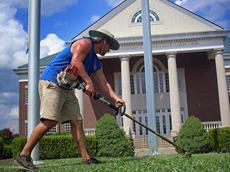 """<div class=""""source"""">KACIE GOODE/The Kentucky Standard</div><div class=""""image-desc"""">Austin Douglas where's cool clothing, sunglasses and a protective hat on a recent summer day while weedeating around the Nelson County Justice Center.</div><div class=""""buy-pic""""><a href=""""/photo_select/78198"""">Buy this photo</a></div>"""