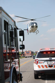 """<div class=""""source"""">RANDY PATRICK/The Kentucky Standard</div><div class=""""image-desc"""">A medical helicopter lands between emergency service vehicles on U.S. 31E to transport a patient to University of Louisville Hospital. Two others were taken by ambulance.</div><div class=""""buy-pic""""><a href=""""/photo_select/95246"""">Buy this photo</a></div>"""