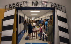 "<div class=""source"">KACIE GOODE/The Kentucky Standard</div><div class=""image-desc"">Arbeit macht frei appears on the entrance of Old Kentucky Home Middle School's Holocaust museum experience Thursday night. The German phrase, which means ""work sets you free,"" appeared on the entrance of many Nazi concentration camps.</div><div class=""buy-pic""><a href=""/photo_select/103176"">Buy this photo</a></div>"
