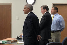 """<div class=""""source"""">FORREST BERKSHIRE/The Kentucky Standard</div><div class=""""image-desc"""">Brooks Houck, far right, stands accused of stealing roofing shingles from Lowe&#039;s home improvement store last year. His trial on felony theft charges, which began Tuesday, was moved to Warren County because of pretrial publicity involving an unrelated criminal investigation in which Houck is a suspect.</div><div class=""""buy-pic""""></div>"""