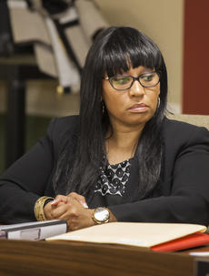 "<div class=""source"">FORREST BERKSHIRE/The Kentucky Standard</div><div class=""image-desc"">City Councilwoman Kecia Copeland listens Tuesday night as a motion is made to schedule a hearing that could lead to the removal of Bardstown Mayor John Royalty. A three-month investigation found that Copeland was targeted by Royalty and alleged the mayor used the power of his office to invade her private email accounts in an effort to cost her the November election.</div><div class=""buy-pic""><a href=""/photo_select/84497"">Buy this photo</a></div>"