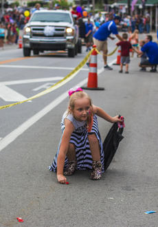 "<div class=""source"">KACIE GOODE/The Kentucky Standard</div><div class=""image-desc"">A little girl grabs candy tossed into the crowd Saturday during Saturday's Iron Horse Festival parade.</div><div class=""buy-pic""><a href=""/photo_select/98063"">Buy this photo</a></div>"