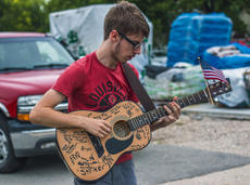 "<div class=""source"">KACIE GOODE/The Kentucky Standard</div><div class=""image-desc"">Austin Walden plays guitar Saturday during the 2018 Rolling Fork Iron Horse Festival in New Haven.</div><div class=""buy-pic""><a href=""/photo_select/98075"">Buy this photo</a></div>"