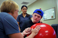 """<div class=""""source"""">KACIE GOODE/The Kentucky Standard</div><div class=""""image-desc"""">Jarett Rogers looks at the camera while doing an exercise at Frazier Rehab at Flaget. The 20-year-old has been doing rehab for three years following brain toxicity from chemo treatments he received for leukemia.</div><div class=""""buy-pic""""><a href=""""/photo_select/90193"""">Buy this photo</a></div>"""