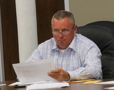 """<div class=""""source"""">RANDY PATRICK/The Kentucky Standard</div><div class=""""image-desc"""">Magistrate Jeff Lear listens to a staff member's report during Tuesday's Fiscal Court meeting.</div><div class=""""buy-pic""""><a href=""""/photo_select/102580"""">Buy this photo</a></div>"""