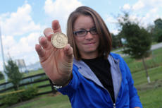 "<div class=""source"">JENNIFER GROTE/The Kentucky Standard</div><div class=""image-desc"">Jenny Brumley, a recent graduate of the Nelson County Drug Court program, displays a coin commemorating her two years of sobriety. </div><div class=""buy-pic""><a href=""/photo_select/59594"">Buy this photo</a></div>"