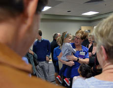"<div class=""source"">KACIE GOODE/The Kentucky Standard</div><div class=""image-desc"">Jill Clark is surrounded by her family, friends and coworkers Monday afternoon at Flaget Memorial Hospital after being recognized as a KentuckyOne Health Employee of the Year.</div><div class=""buy-pic""><a href=""/photo_select/90817"">Buy this photo</a></div>"