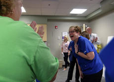 "<div class=""source"">KACIE GOODE/The Kentucky Standard</div><div class=""image-desc"">Jill Clark is surprised as she enters a room full of her family, friends and coworkers Monday afternoon at Flaget Memorial Hospital. Clark was recognized as a KentuckyOne Health Employee of the Year.</div><div class=""buy-pic""><a href=""/photo_select/90818"">Buy this photo</a></div>"