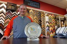 "<div class=""source"">KACIE GOODE/The Kentucky Standard</div><div class=""image-desc"">Jimmy Gartland, manager of Gartland's Art Sales in Bardstown, poses with the 2018 Festival Unveiled Judge's Award presented to the business for framing this year's Kentucky Derby Festival poster.</div><div class=""buy-pic""><a href=""/photo_select/94761"">Buy this photo</a></div>"