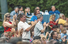 "<div class=""source"">KACIE GOODE/The Kentucky Standard</div><div class=""image-desc"">Fans applaud the band during Resurrection: A Journey Tribute's performance Monday night at the J. Dan Talbott Amphitheatre.</div><div class=""buy-pic""><a href=""/photo_select/96252"">Buy this photo</a></div>"