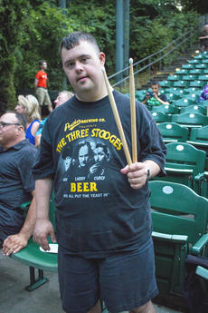 "<div class=""source"">KACIE GOODE/The Kentucky Standard</div><div class=""image-desc"">Scott Burt holds up drum sticks he received from the band Monday night during the kick off of the Live at the Park concert series at the amphitheater. Resurrection: A Journey Tribute took the stage.</div><div class=""buy-pic""><a href=""/photo_select/96258"">Buy this photo</a></div>"