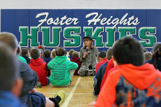 "<div class=""source"">KACIE GOODE/The Kentucky Standard</div><div class=""image-desc"">Author Julia Cook sits and talks with elementary school students at Foster Heights Friday morning as part of her tour through Bardstown and Nelson County schools. Cook has written more than 80 books for kids that focus on real-world problems and problem solving. Some of the books she shared with local kids addressed having a bad attitude, cyber safety and how to spot kidnappers and child predators. </div><div class=""buy-pic""><a href=""/photo_select/91472"">Buy this photo</a></div>"