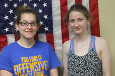 """<div class=""""source"""">RANDY PATRICK/The Kentucky Standard</div><div class=""""image-desc"""">Sisters Elizabeth Kaczmarek, 20, left, and Hannah Kaczmarek, 22, decided to become volunteer firefighters together, following in the footsteps of their stepfather.</div><div class=""""buy-pic""""><a href=""""/photo_select/95918"""">Buy this photo</a></div>"""