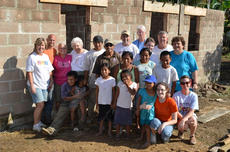 "<div class=""source"">PHOTO SUBMITTED</div><div class=""image-desc"">Volunteers stand outside the new concrete home constructed for the Ogaldez family in Las Flores, Belize, in honor of JT and Tootsie Cecil. </div><div class=""buy-pic""></div>"
