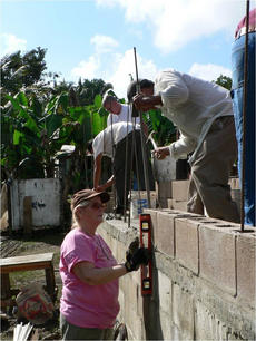 "<div class=""source"">PHOTO SUBMITTED</div><div class=""image-desc"">Volunteers help lay the concrete foundation for a home in Las Flores, Belize. </div><div class=""buy-pic""></div>"