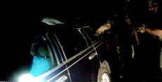 """<div class=""""source""""></div><div class=""""image-desc"""">A still shot from a Bardstown Police officer's body camera shows the arm of former Lt. Brad Gillock dropping an incendiary device into the vehicle of a suicidal subject while former Interim Police Chief McKenzie Mattingly covers him (in the top right corner of the frame). The subject shot himself seconds afterward, and the city is now defending itself from a lawsuit from the actions taken that night</div><div class=""""buy-pic""""><a href=""""/photo_select/92206"""">Buy this photo</a></div>"""
